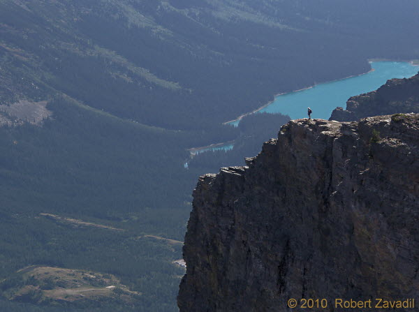 Photo of Hiker Overlooking Josephine Lake in Glacier National Park