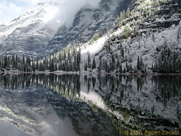 Photo of winter Avalanche Lake in Glacier National Park